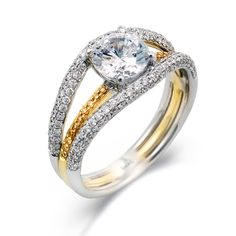 Runway Collection - This gorgeous 18K two tone engagement ring is comprised of .53ctw round white Diamonds and .09ctw round yellow Diamonds.  - MR1534