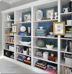 Billy bookcases from Ikea with added moldings and trim for a custom look: Centsational Girl.