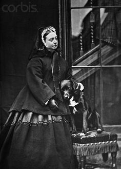 Queen Victoria with one of her pet dogs, Sharp. She loved her dogs dearly and had portraits made of them. Sharp was a Border Collie. The Queen is actually smiling a little in the photo.