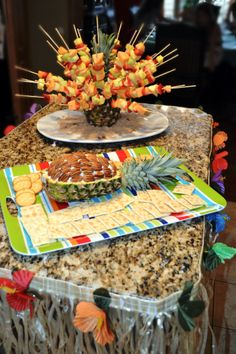 Hosting a Luau? This was a winter luau done inside in January. Eye-popping fruit bouquet and pineapple/pecan cheese dip were a big hit with the kids and adults! Need more ideas? Go to www.ohcelebrate.com!