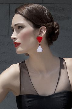 Hourglass earrings. $39 http://www.theandeancollection.com/ViewProduct.aspx?choice=203