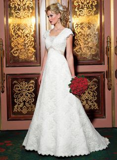 Grace Kelly - by Maggie Sottero  All over lace gown with lace insert and satin sash. Beautiful and modest LDS bridal gown.