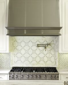 Kitchen hood; lovely tile backsplash - Handmade tiles can be colour coordinated and customized re. shape, texture, pattern, etc. by ceramic design studios