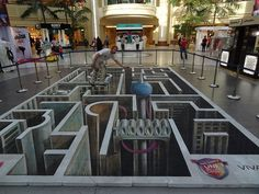 Aren't I supposed to be in the maze, and not on top of it?  3D Street Painting in Kuwait
