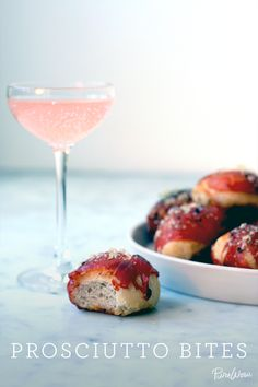 Bite-sized balls of pre-made pizza dough, wrapped in slices of salty prosciutto and coated with Parmesan cheese.