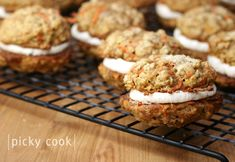 carrot cake sandwich cookies with cream cheese frosting filling