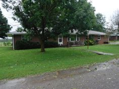 Beautiful spacious all brick home on a corner lot overlooking rolling pastures to the back. Sits on the edge of town with 3 BR, 2 BA and 2 living areas. New roof in 2012. New windows, soffits & guttering in 2007. The kitchen features lots of cabinets, bar, new cook top in 2013 & a computer area. New heat and air in 2013 along with new screen doors. Newer hot water heater in Miller MO