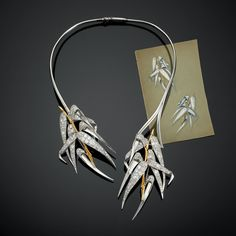 This vintage diamond necklace by Belperron features bamboo leaves in platinum, gold and diamonds. A very versatile piece where the leaves can also be detached and worn as brooches (price on request).