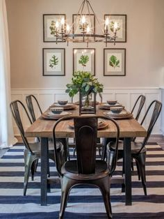 The footprint of the original dining room was actually reduced somewhat to allow the expansion of the kitchen. The space still feels roomy and well suited for entertaining. Joanna added a farm style table, industrial metal chairs and botanical prints in s