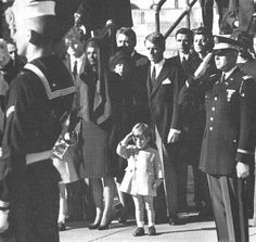 Jackie Kennedy stands with her son John F. Kennedy Jr. and Robert Kennedy at her husband's funeral