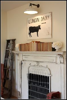 look at this!!! an old gate used as a fire place screen - very creative! from My Sweet Savannah: ~the most inspiring house and a one kings lane sale~