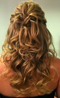 Even thin hair can look thicker in this classic half up and half down style by adding lots of curl and volume.