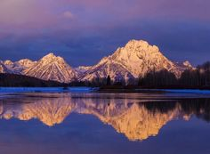 Mornings in Grand Teton National Park (Wyoming) are breathtaking. Pictured here is the park's Mount Moran illuminated by the early morning light and reflected in the Snake River. Sunrise photo courtesy of Duane Jurma. — at Grand Teton National Park.