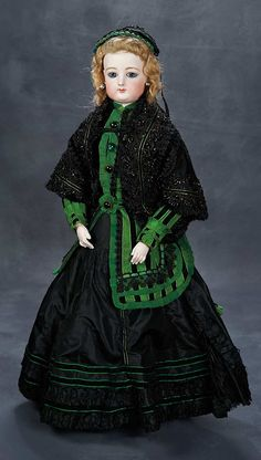Large French Bisque Poupee by Gaultier with Deposed Gesland Body, wearing very fine antique silk costume of black and green taffeta with black lace trim,and black beaded jacket, bonnet, undergarments, leather boots. Circa 1872.
