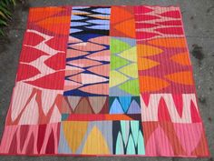 Kathy Anso, New Zealand. central coloured panels made in class with Nancy Crow, enlarged to queen bed size