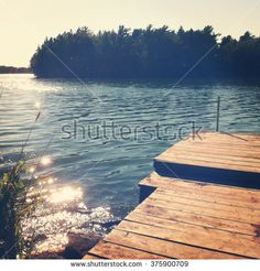 Beautiful view of pond with boat dock - stock photo