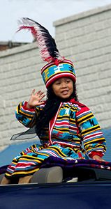 Seminole youth wearing traditional Seminole patchwork