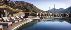 Surrender at The Spa Serenity pool at The Ritz-Carlton, Dove Mountain, cradled by a blanket of peaceful desert mountain.