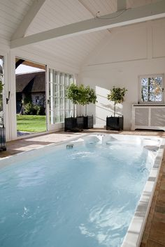 a hydropool hot tub and self cleaning swim spa sunk into composite swimming pool spa 14 fx aquatrainer by hydropool