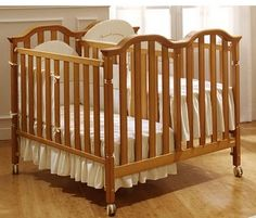 Crib for twins : Babies world. Love the shared side.