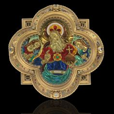 A gold and enamelled barbed quatrefoil plaque in the form of a Pax in the Renaissance taste, lavishly decorated with red, green and blue basse taille enamels used to depict the elaborate folds of the drapery of the figures within, that in the centre being Christ Salvator Mundi (Saviour of the World) shown wearing a similarly shaped pax and flanked by two angels (Cherubim and Seraphim),
