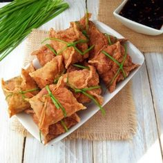 Thai golden bags filled with tofu and shiitake mushrooms and lightly spiced with Thai curry paste and served with sweet chili sauce. A great vegan party appetizer!