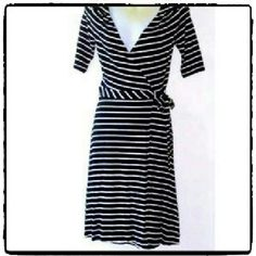 H & M STRIPED WRAP DRESS NWOT Classic wrap dress.  With 3/4 sleeves and above the knee length. Very cute H&M Dresses