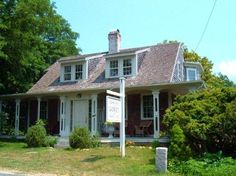Elephant House - Otherwise known as the home of author, illustrator, puppeteer & playwright Edward Gorey, is a unique example of the Cape Cod architectural style. Familiar elements of a Cape Cod, such as the central roof, dormers, twin windows & steep roof, can be seen here.
