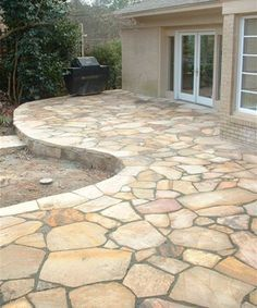 Crazy paving raised patio curved
