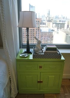 Meredith's NYC Apartment -- Lovely green nightstand that doubles as storage. | meredithandthenewyorkie.com
