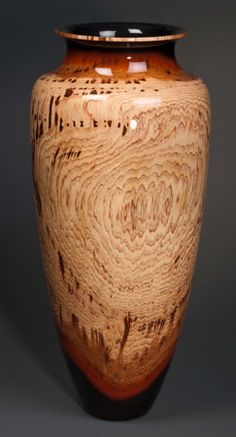 Steve Sinner and Joe Meirhaeghe are true collaborators on the  wood-turned vessels shown at Iowa Artisans Gallery.