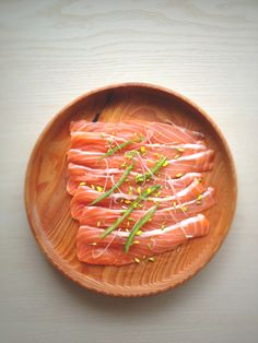 Cold cured salmon made by adding salt, sugar, and pepper then placing in a refrigorator and flipping every 12 hours for 3 days