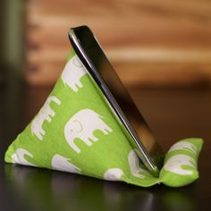 iPhone/iPod Mobile Device Stand ~ I WILL make one of these!  Will need to find something to go inside of it that is washable though, or water proof/spill proof fabric since I need it for my kitchen table.  Always i-ing while eating lunch!