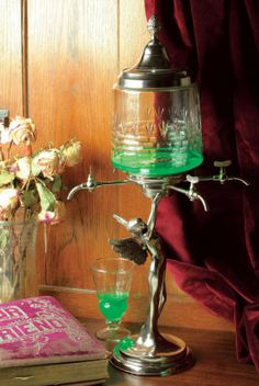 Fairy Absinthe Decanter. This exotic drink urn offers 4 spigots from which to drop the drink upon sugar cubes.