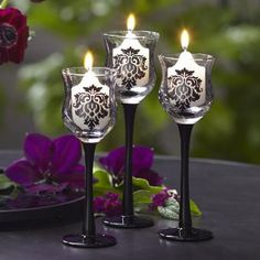 FORBIDDEN TRIO: A romantic damask motif and midnight black stems add drama to our curvy glass candle holders.