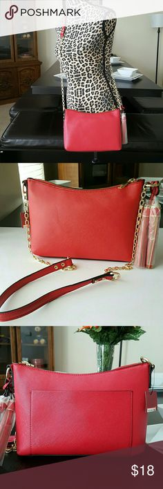 """Merona Crossbody Bag New with tags   Can be worn as shoulder or crossbody   Gorgeous   COLOR RED  MERONA BRAND  One pocket on the back  and 1 zipper pocket and flap pocket inside  Measurements Appox   11""""L X 6""""H Merona Bags Crossbody Bags"""
