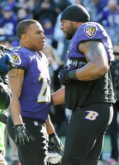 Ray Lewis talks to running back Ray Rice before kickoff.