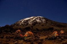 """1st Place – Jeff Rennicke – """"Kilimanjaro by Starlight"""" - All Photography Art Exhibition -  Jeff Rennicke is a nationally-known writer and photographer whose work has appeared in National Geographic Traveler, Reader's Digest, Backpacker and more. Jeff is also a dynamic public speaker and a frequent lecturer for the National Geographic Society's Expedition program. He lives in Bayfield, Wisconsin which is near Lake Superior. His website is www.jeffrennicke.com"""