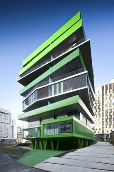 neon green irregular angular layered housing complex design = Villiot-Rapée Apartments |  Hamonic + Masson