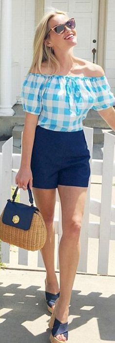 Who made  Reese Witherspoon's brown handbag, mule sandals, sunglasses, blue shorts, white plaid shirt?