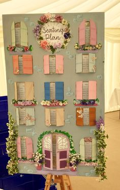 Wedding Seating plan made from cardboard, paint, and fake flower heads Serena and Robins wedding 15/7/17