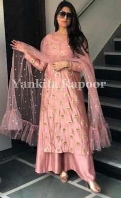 Salwar suits party wear - Get your Charming look in this net western wear Bollywood Suit with Heavy embroidered work in sparkling motifs trendy palazzo onlineboutique westernwear palazzo ootdfashion bridalboutique weddi Party Wear Indian Dresses, Salwar Suits Party Wear, Designer Party Wear Dresses, Indian Gowns Dresses, Kurti Designs Party Wear, Dress Indian Style, Pakistani Dresses, Indian Outfits, Designer Wear
