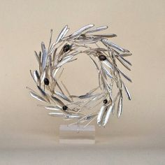 Greek Olive Tree Wreath, Olive Tree Real Natural Branch, Fine Silver Electroplated Real Olive Organic Eco Sculpture, Greek Nature Home Decor $208.36  Only 1 available  Overview      Handmade item     Materials: real Greek olive branch, galvanoplasty on real tree branch, silver electroplated real olive, fine silver 999     Made to order     Ships worldwide from Greece