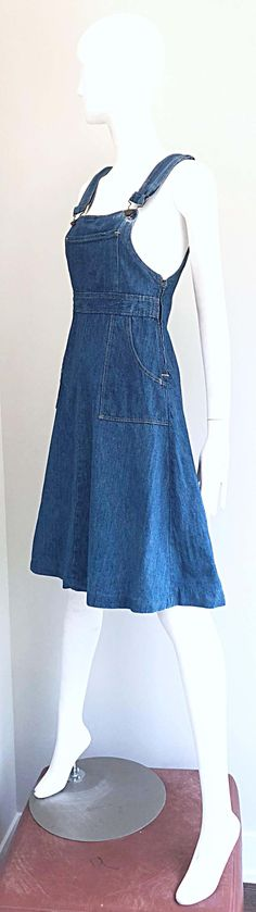 For Sale on 1stDibs - Rare early 1970s THE GAP denim overalls blue jeans dress! From one of the first to collections from The Gap in 1971. Features a fitted bodice itch an A-Line