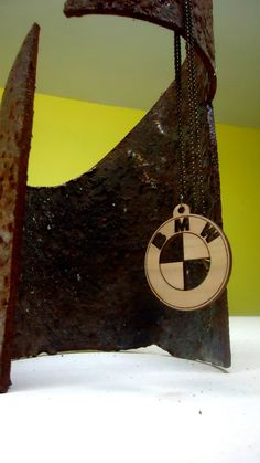 The necklace is made from wood. - Laser cut. dimension: diameter 45mm thickness 3mm Necklace lenght430mm