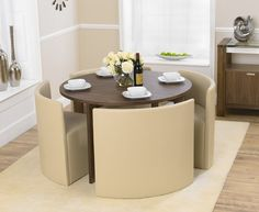 Buy the Oslo 120cm Walnut Stowaway Dining Table and Chairs at Oak Furniture Superstore