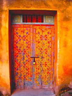 Awesome orange door! Especially all the intricate details.