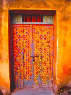 warm colors, door design, door colors, orang door, front doors, painted doors, colorful doors, wooden doors, beauti door