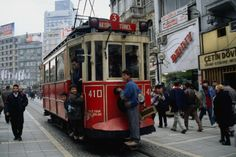 View along Taksim Square with a tram in the foreground, Istanbul. Except for the tram this is a pedestrian only street.