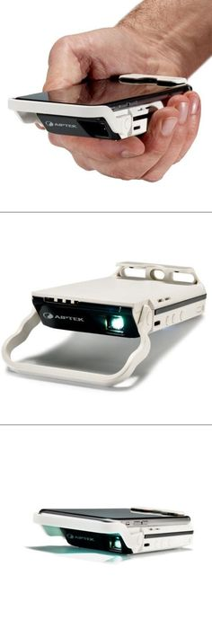 Now you can have the luxury of a big screen movie in the palm of your hand! With a portable HD projector for your iPhone you can use your phone to project movies on screens up to 60 inches! The sky is (Apple Tech Products) New Gadgets, Gadgets And Gizmos, Technology Gadgets, New Technology, Kitchen Gadgets, Cool Technology Gifts, Iphone Gadgets, Baby Gadgets, High Tech Gadgets